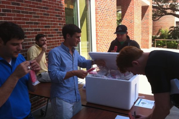 TEA and Net Impact members sponsor free Pete's Pedal Pops on the back patio of GWII on a su